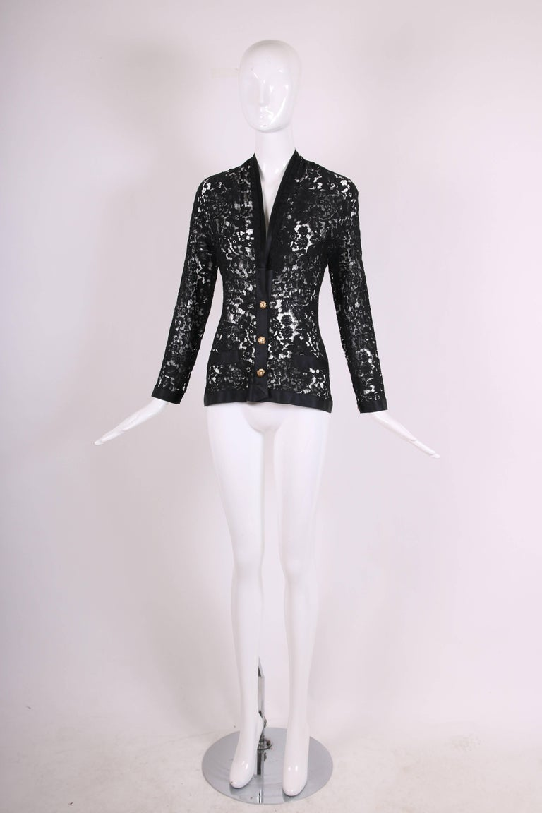 Women's Chanel Black Lace Jacket with Black Silk Trim and Gold tone Camellia Buttons For Sale