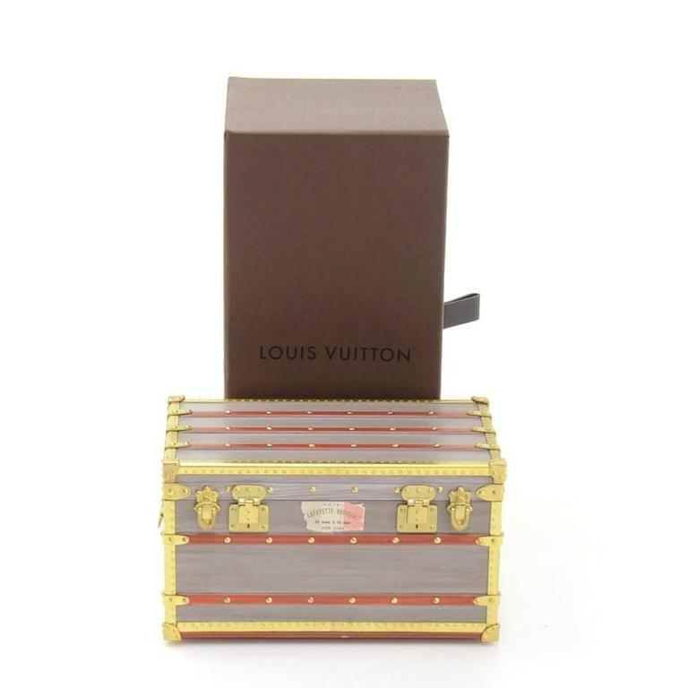 """CURATOR'S NOTES  Louis Vuitton mini malle trunk VIP gift on the collection ceremony. The lid opens to reveal space to keep small treasures or jewelry.  Excellent for travel.  Made in France Measures 4.3"""" L x 2.6"""" W x 2.6"""" D  Includes original"""
