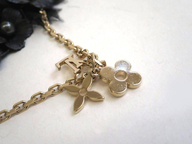 Women's Louis Vuitton Mixed Media Gold Chain Rhinestone Flower Charm Necklace in Box For Sale