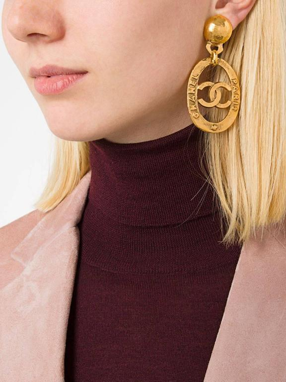 CURATOR'S NOTES  Metal Gold tone Clip on closure  Made in France Drop 2