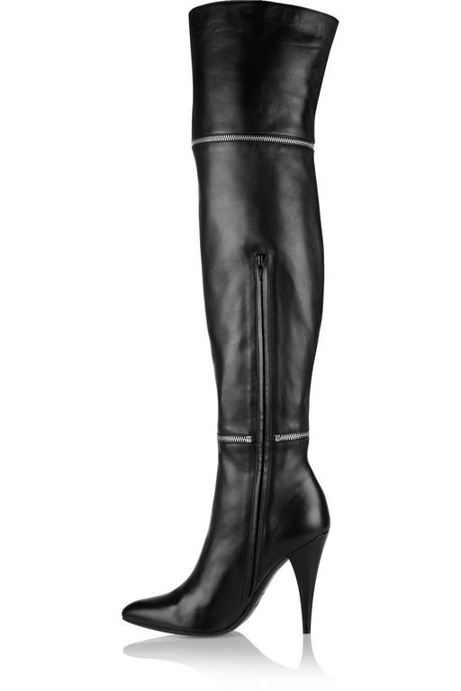 "CURATOR'S NOTES  Saint Laurent NEW Black Leather Zipper Over the Knee Heels Boots in Box available at Newfound Luxury   Size IT 36 Leather Silver hardware Zipper closure Leather lining Made in Italy Heel height 4"" Includes original Saint"