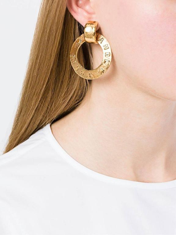 "Chanel Vintage Gold 'Chanel Paris' Round Two in One Dangle Doorknocker Earrings  Metal Gold tone Clip on closure Made in France Width 2"" Drop 2.2"""