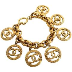 Chanel Vintage Gold Medallion Coin CC Charms Chain Link Dangle Cuff Bracelet
