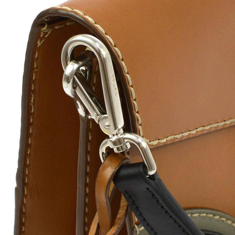 "CURATOR'S NOTES  Prada Cognac Leather Colorblock Kelly Style Top Handle Satchel Flap Bag available at Newfound Luxury  Leather Silver tone hardware Push lock closure Made in Italy Strap handle drop 6"" Measures 10"" W x 7.5"" H x"
