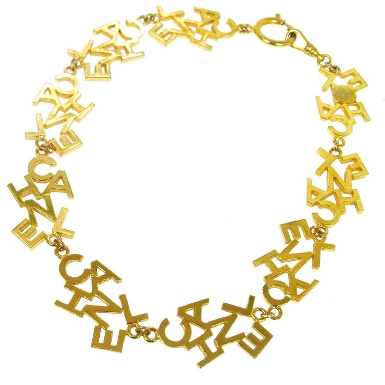 Chanel Vintage Gold 'CHANEL' Charm Letters Choker Necklace For Sale