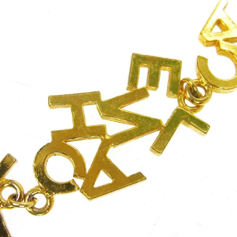 Chanel Vintage Gold 'CHANEL' Charm Letters Choker Necklace In Good Condition For Sale In Chicago, IL