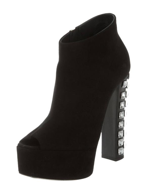 "CURATOR'S NOTES  Giuseppe Zanotti NEW & SOLD OUT Black Suede Embellished Ankle Booties in Box available at Newfound Luxury   Size IT 37 Suede Jewel detail Resin heels  Zipper closure Made in Italy Heel height 5.75"" Includes original Giuseppe"