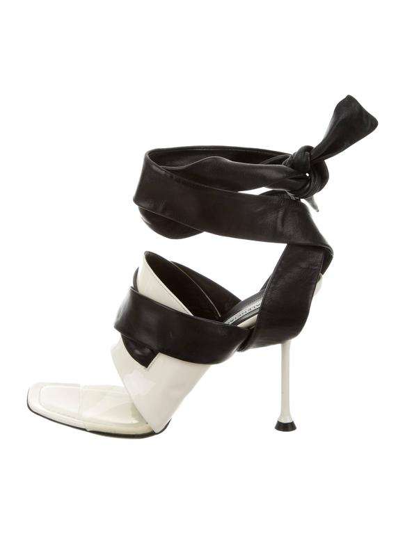 "CURATOR'S NOTES  Balenciaga NEW & SOLD OUT Cut Out Heels in Box available at Newfound Luxury   Size 37.5 Patent leather PVC Wrap around closure Made in Italy Heel height 4"" Includes original Balenciaga box"