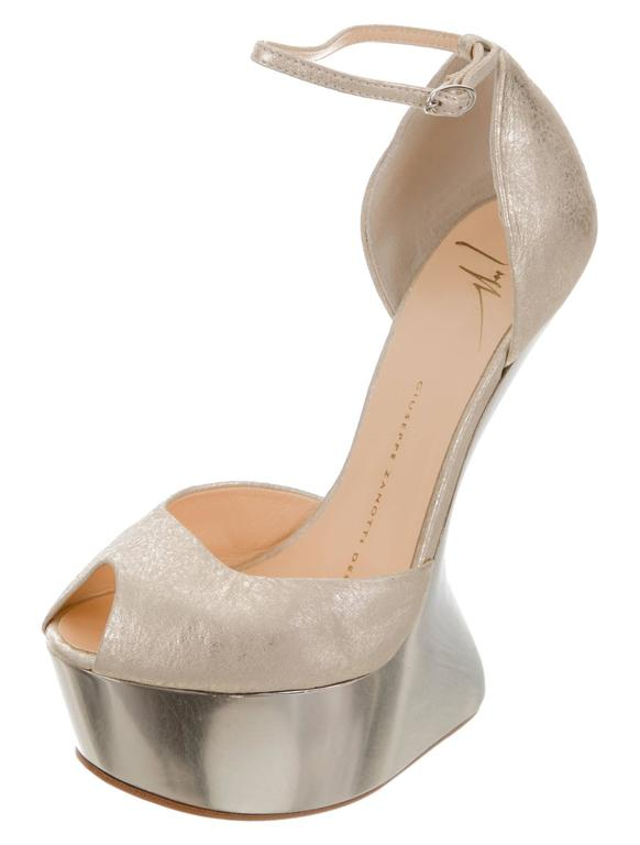 """CURATOR'S NOTES  Giuseppe Zanotti NEW & SOLD OUT Champagne Gold Futuristic Leather Wedge Sandals Heels in Box available at Newfound Luxury   Size IT 36.5 Leather  Adjustable ankle closure Made in Italy Heel height 6"""" Includes original"""