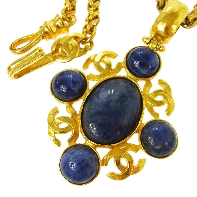 """Chanel Vintage Rare Gripoix Blue Gold Multi Point Charm Evening Drape Necklace available at Newfound Luxury  Gripoix poured glass Metal Gold tone Lobster claw closure Made in France Charm measures 2"""" Chain length 34""""  Shop Newfound Luxury"""