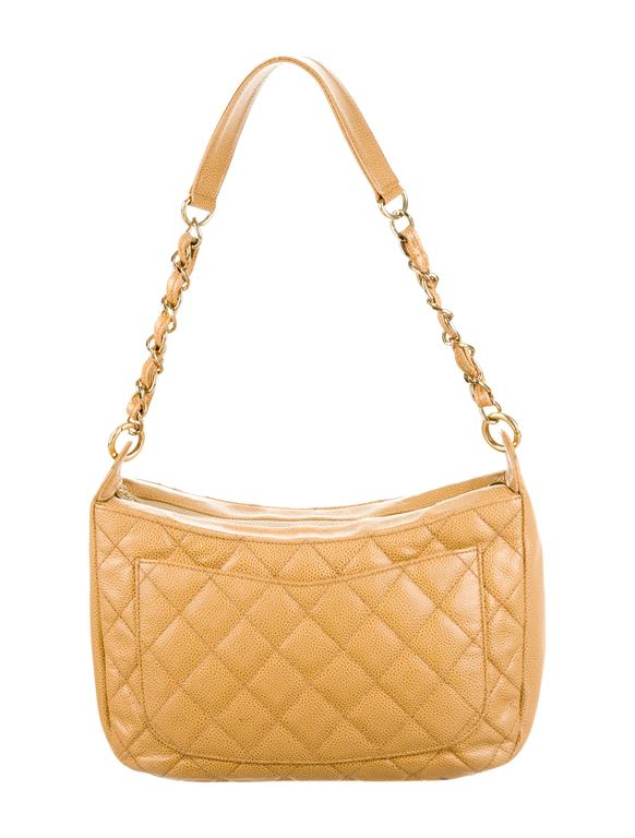 "CURATOR'S NOTES  Chanel Nude Caviar Leather Gold Evening Top Handle Satchel Chain Shoulder Bag available at Newfound Luxury  Caviar leather Gold tone hardware  Zipper closure Made in France Date code 8100679 Shoulder strap 10.5"" Measures"