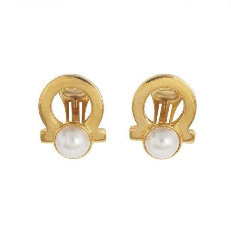 d56eded29 Salvatore Ferragamo Gold Logo Pearl Evening Stud Earrings at 1stdibs