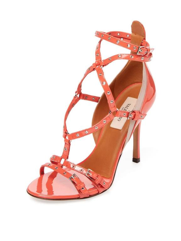 "CURATOR'S NOTES    Valentino New Coral Patent Leather Strappy Cut Out Sandals Heels in Box available at Newfound Luxury   Size IT 36 Patent leather  Leather  Silver tone hardware Ankle buckle closure Made in Italy  Heel height 4""  Includes original"