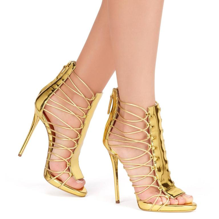 "Giuseppe Zanotti New Gold Leather Gladiator Sandals Heels in Box available at Newfound Luxury   Size IT 36 Leather Zipper back closure Made in Italy Heel height 4.75"" Includes original Giuseppe Zanotti box"