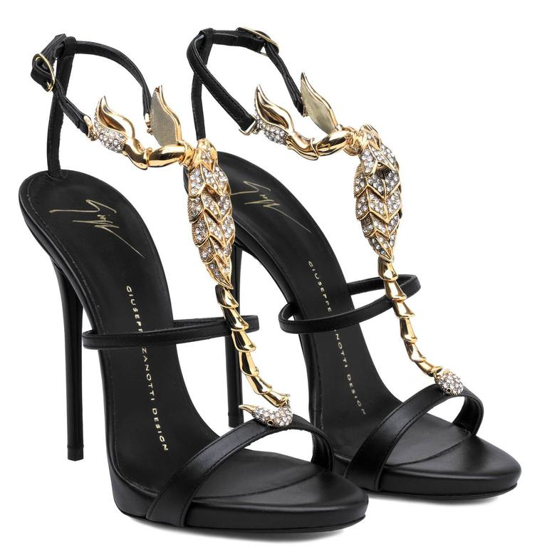 "Giuseppe Zanotti New Sold Out Black Leather Gold Crystal Evening Sandals Heels in Box available at Newfound Luxury   Size IT 38 Leather Crystal  Adjustable ankle buckle closure Made in Italy Heel height 4.5"" (115mm) Includes original Giuseppe"