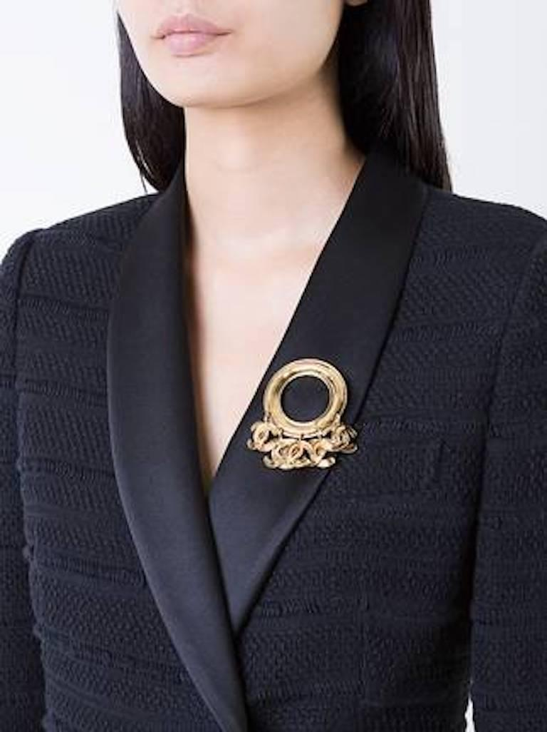 Chanel Vintage Gold Round Hanging Charms Evening Brooch in Box   Metal Gold tone Pin closure Made in France Measures 2