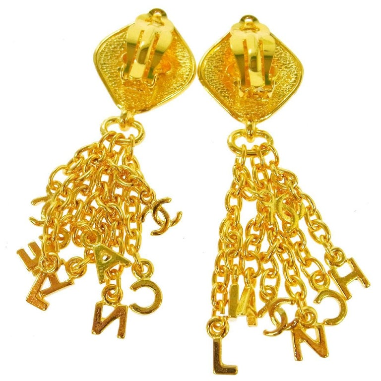 Chanel Vintage Gold CHANEL Charm Dangle Drop Evening Earrings   Metal Gold tone Clip on closure Made in France Width 1