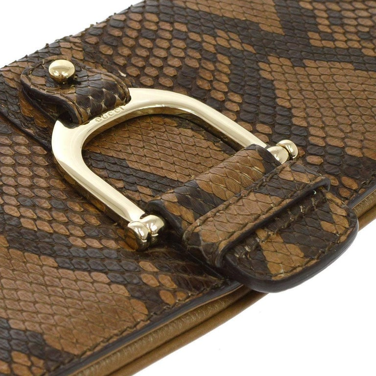 Gucci Cognac Taupe Black Snakeskin Leather Gold Horsebit Evening Clutch Bag    Snakeskin Leather Gold tone hardware Magnetic closure Twill lining  Made in Italy Measures 12