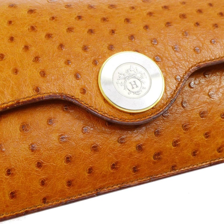 Hermes Vintage Cognac Ostrich Leather Envelope Evening Clutch Flap Bag   Ostrich leather Silver and gold tone hardware Magnetic closure Made in France Date code Circle Y Measures 10