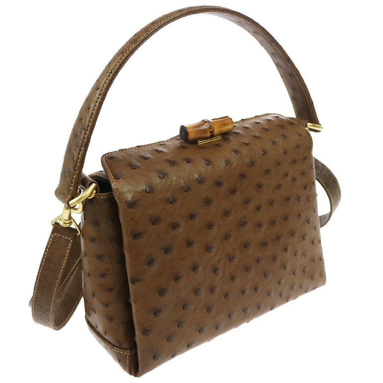 "Gucci Taupe Brown Ostrich Leather Bamboo Kelly Style Top Handle Satchel  Evening Shoulder Bag available at Newfound Luxury   Ostrich leather Bamboo Gold tone hardware Made in Italy Handle drop 7"" Removable shoulder strap drop 22"" Measures"
