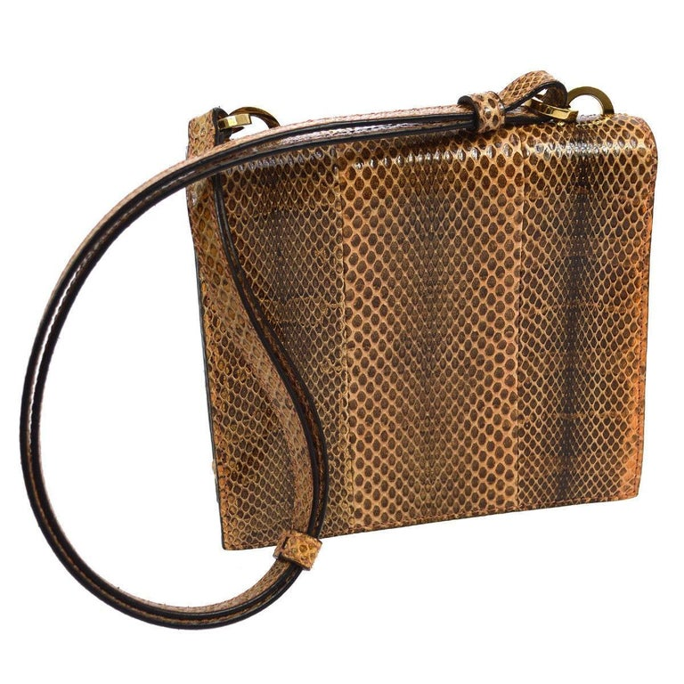 "Gucci Cognac Brown Snakeskin Saddle Top Handle Evening Flap Shoulder Bag available at Newfound Luxury   Snakeskin (Python) Gold tone hardware Lock closure Leather lining Made in Italy Shoulder strap drop 10"" Measures 5"" W x 5.5"" H x"