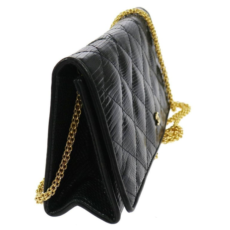 "Chanel Black Lizard Leather Gold Chain 2 in 1 Clutch Flap Evening Shoulder Bag at Newfound Luxury   Gold tone hardware Snap button closure Leather lining Made in Italy Chain strap drop 20"" Measures  9"" W x 4"" H x 2"" D"