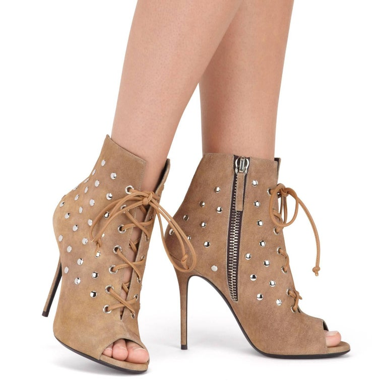 "Giuseppe Zanotti New Sold Out Cognac Tan Brown Suede Silver Stud Ankle Booties Heels in Box  Size IT 36 - Need a different size?  Message us for help. Suede Metal hardware Lace up closure Made in Italy Heel height 4.1"" Includes original"