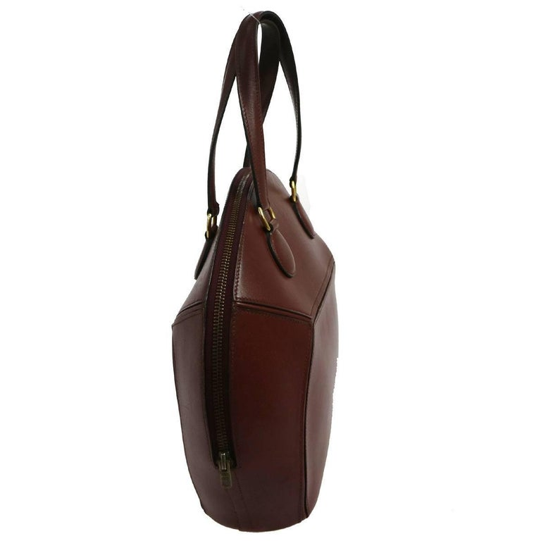 """Hermes Vintage Bordeaux Red Leather Evening Bowling Top Handle Satchel Tote Bag available at Newfound Luxury   Leather Zipper closure Leather lining Date code Circle V  Made in France Handle drop 6"""" Measures 11"""" W x 11"""" H x 4"""" D"""
