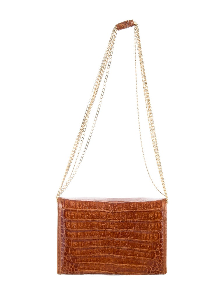 """Chanel Cognac Crocodile CC Gold Chain Evening Clutch Shoulder Flap Bag   Crocodile  Gold tone hardware Leather lining Snap closure Dote code present Made in Italy Shoulder strap drop 14"""" Measures 8"""" W x 5"""" H x 3"""" D"""
