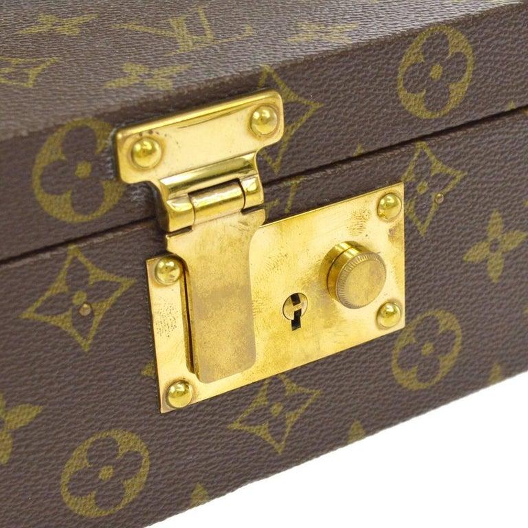 """Louis Vuitton Monogram Canvas Men's Women's Jewelry Evening Travel Top Handle Storage Bag Case With Keys   Monogram canvas Leather Leather lining Handle drop 2"""" Measures 8.75"""" W x 3.5"""" H x 5.5"""" D   Includes original Louis Vuitton"""