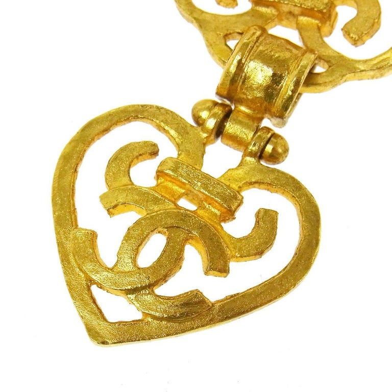 Chanel Gold Heart Filigree Mirror Charm Long Drape Chain Evening Necklace With Box  Metal Gold tone hardware Mirror  Lobster claw closure Made in France Charm measures 2.5