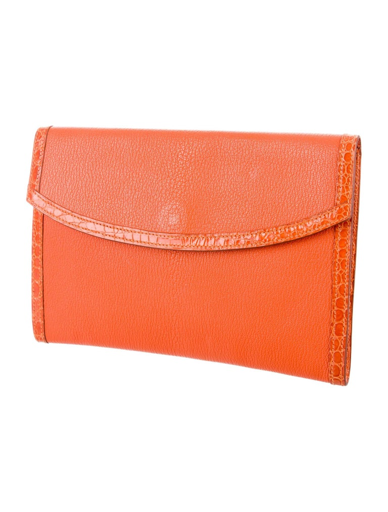 "Hermes Orange Leather Crocodile Trim Envelope Evening Clutch Flap Bag  Leather Crocodile Gold tone hardware Leather lining Magnetic closure  Date code Square H  Measures 9.25"" W x 6.25"" H x 0.5"" D"
