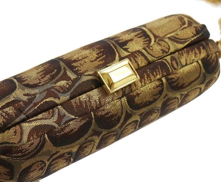 "BOttega Veneta Brown Gold Canvas Snakeprint Tassel Evening Clutch Bag  Canvas Fabric Gold tone hardware  Satin lining Made in Italy Measures 6.25"" W x 4"" H x 1.5"" D"