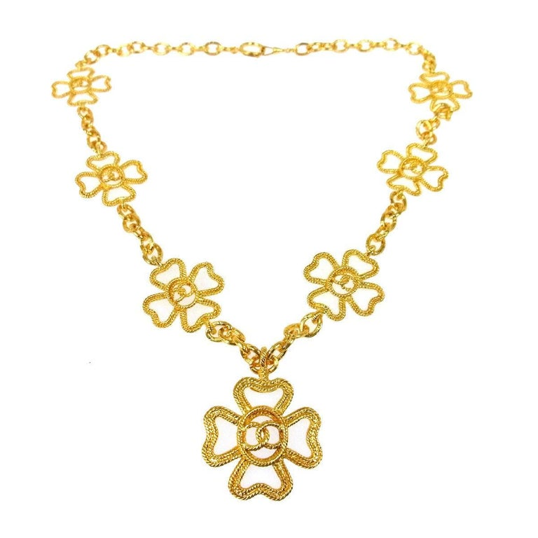 Chanel Gold Textured Multi Cross Charm Drape Drop Evening Pendant Necklace For Sale