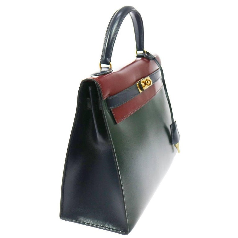 "Hermes Kelly 32 Sellier Bordeaux Green Blue Leather Top Handle Satchel Flap Bag  Leather  Leather lining Gold tone hardware Date code Circle S Made in France Handle drop 4"" Measures 12.5"" W x 9.5"" H x 4.75"" D Includes original"