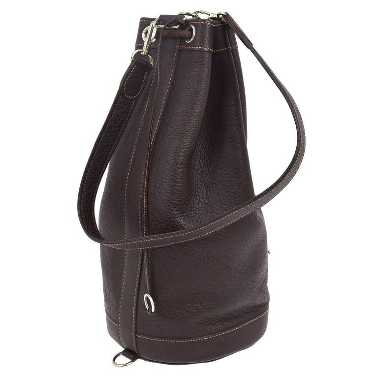 """Hermes Dark Brown Leather Men's Drawstring Bucket Duffle Travel Carryall Shoulder Bag  Leather Silver tone hardware Leather lining Date code Square D Made in France Shoulder strap drop 32"""" Measures 8"""" W x 16.5"""" H x 8"""" D  Includes"""