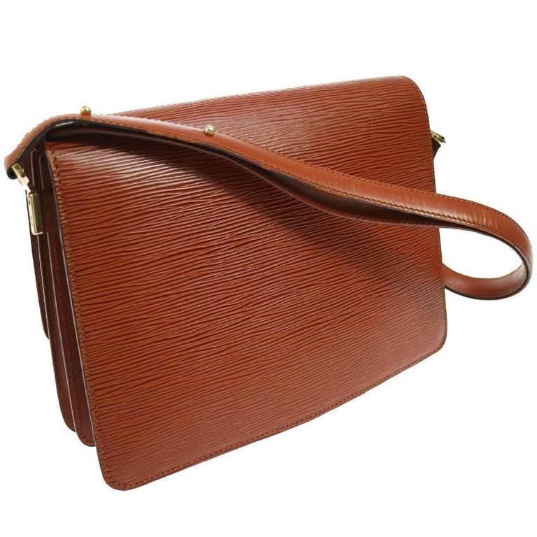 "Louis Vuitton Cognac Leather Top Handle Satchel Evening Shoulder Flap Bag  Leather Gold tone hardware Turnlock closure Leather lining Made in France Adjustable shoulder strap 9-15"" Measures 10.5"" W x 8"" H x 3"" D"