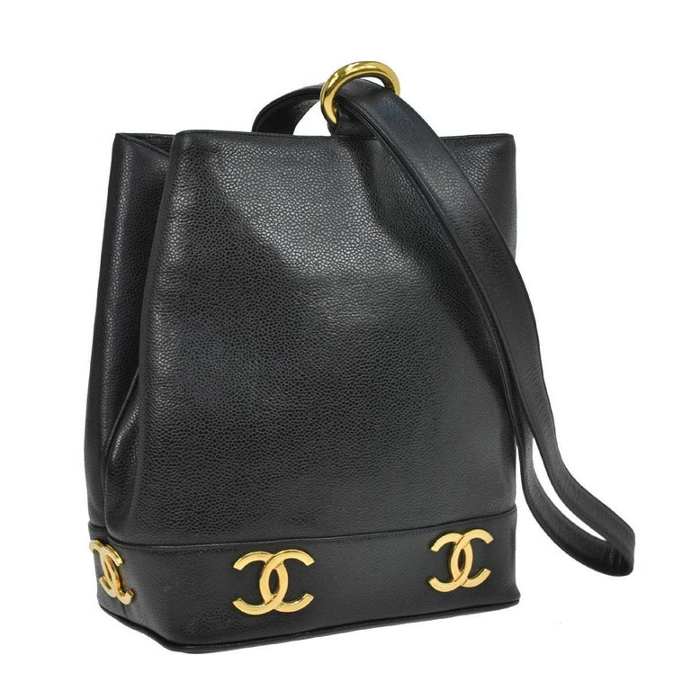 """Chanel Black Leather Gold Charms Sling Back Carryall Duffle Shoulder Bag  Caviar leather Gold tone hardware Date code present  Made in Italy Shoulder strap drop 18"""" Measures 8.25"""" W x 10.25"""" H x 4.75"""" D  Includes original Chanel"""