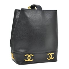 Chanel Black Leather Gold Charms Sling Back Carryall Duffle Shoulder Bag