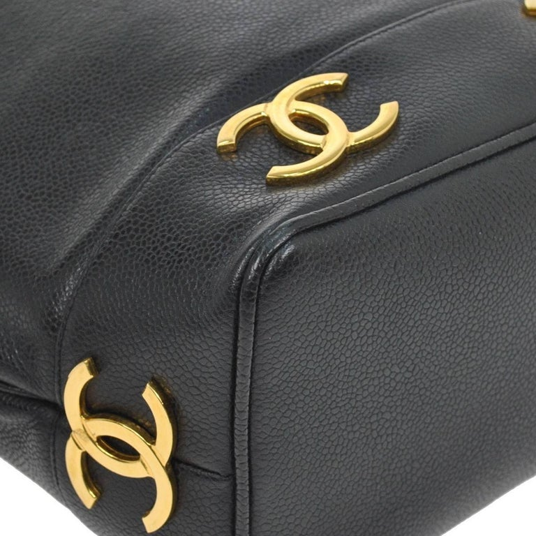 Chanel Black Leather Gold Charms Sling Back Carryall Duffle Shoulder Bag In Excellent Condition For Sale In Chicago, IL