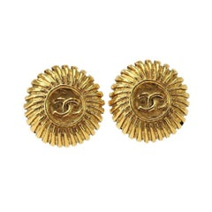Chanel Gold Textured Starburst Charm Evening Stud Earrings in Box