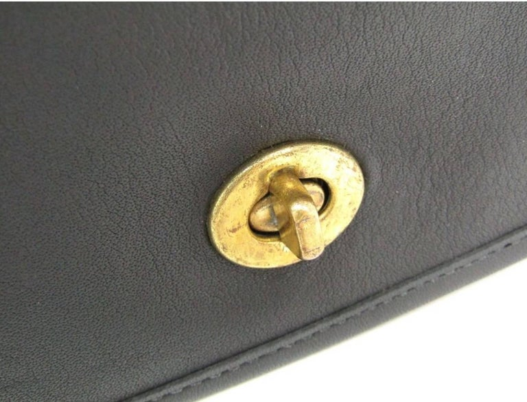 Coach Vintage Archive Black Leather Saddle Crossbody Shoulder Flap Bag  Leather Gold tone hardware Turnlock closure 47c6993e4afb6