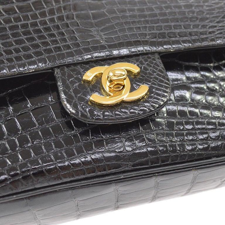 Chanel Black Crocodile Leather Gold Turnlock Evening Clutch Flap Shoulder Bag  Crocodile Gold tone hardware Leather lining Turnlock closure Date code present  Made in France Shoulder strap drop 17