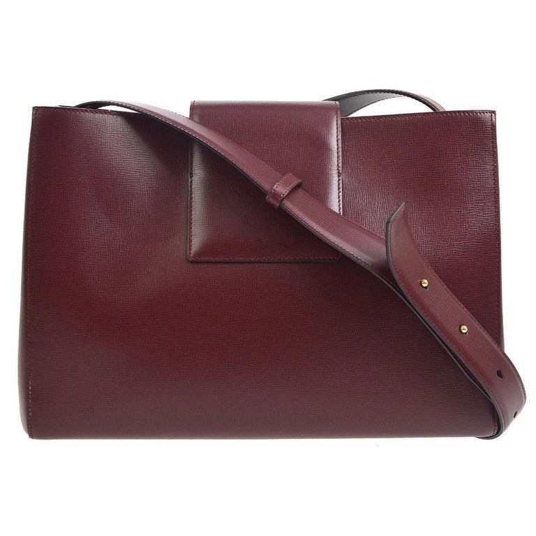Cartier Burgundy Wine Leather Toggle Small Box Top Handle Satchel Tote Bag in Box  Leather Gold tone hardware Toggle closure  Woven lining Made in Italy Adjustable shoulder strap drop 17-18.5