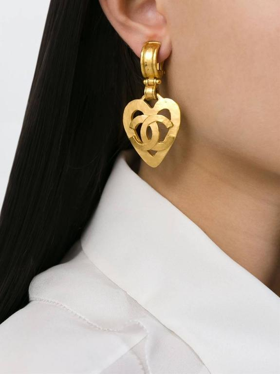 """CURATOR'S NOTES  Be the Queen of Hearts and Chanel with these fab Chanel gold tone heart earrings.  Gold plated Clip on Made in France Measures 2.8"""" L x 1.7"""" W Includes complimentary pair of new earring backs Includes original Chanel box"""