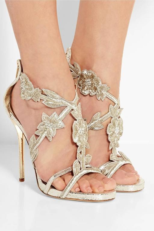 CURATOR'S NOTES  It's wedding season! Whether you are the bride or an invited guest, dazzle in these silver-tone metallic cracked leather Oscar de la Renta heels featuring with PVC panels, gold-tone beaded embellishing and zip closures at ankles.