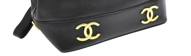 "CURATOR'S NOTES  Chanel Black Caviar Leather Gold Charm Top Handle Sling Back Bag available at Newfound Luxury   Caviar leather Gold tone hardware Through loop closure Leather lining Made in France Shoulder strap drop 19"" Measures 9.5"" W x"