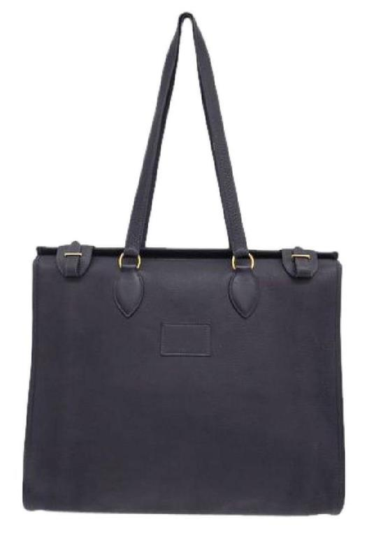 CURATOR'S NOTES  Hermes Leather Oversize Carryall Briefcase Travel Shopper Shoulder Tote Bag available at Newfound Luxury   Leather (Clemence) Gold tone hardware Suede lining Belted closure Made in France Date code Square E  Shoulder strap drop