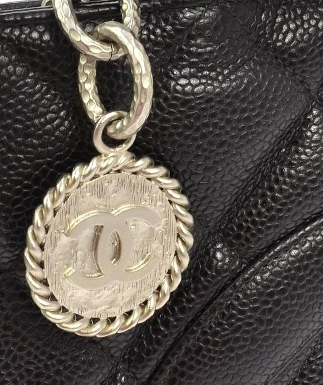 Chanel Black Caviar Leather Silver Medallion Charm Classic Top Handle Tote Bag  Caviar leather  Silver tone hardware  Zipper closure  Date code present  Made in France  Strap drop 7