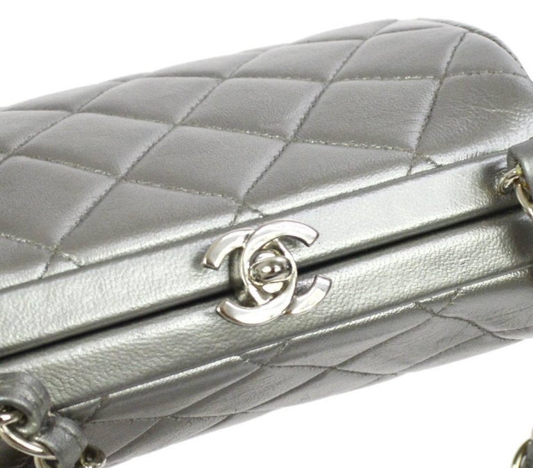 "Chanel Silver Leather Party Kisslock Evening Flap Shoulder Bag  Leather Silver tone hardware Leather lining Made in France Shoulder strap drop 24"" Measures 5.75"" W x 5"" H x 3.5"" D"